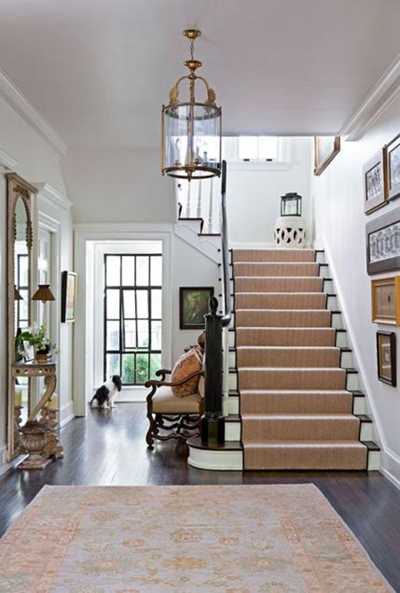 white foyer via Traditional Home magazine