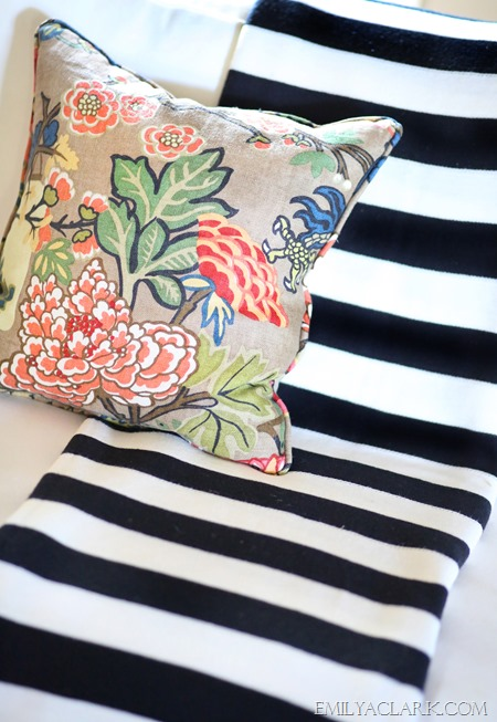striped throw and floral pillow