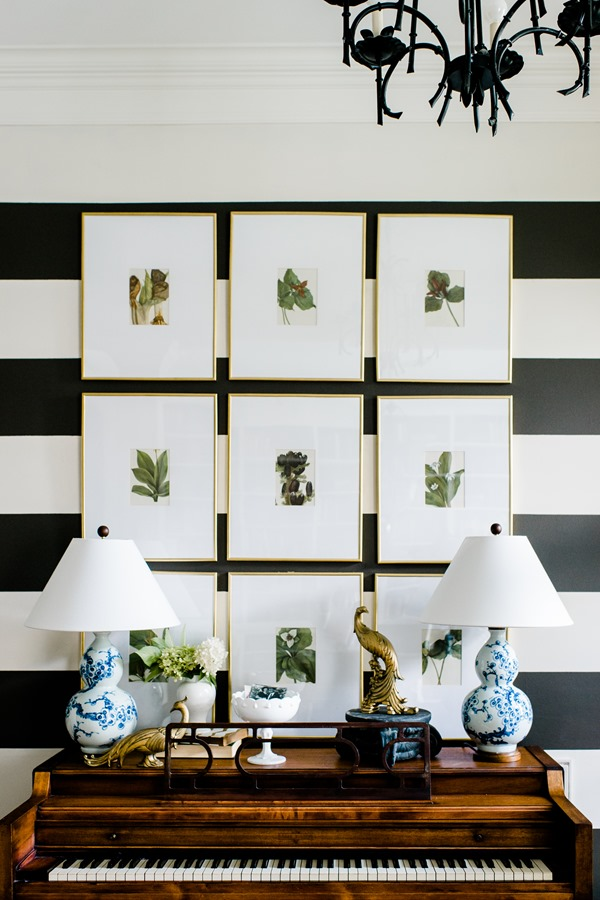 framed botanical art in entryway