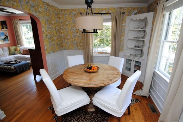 colorful dining room with yellow wallpaper