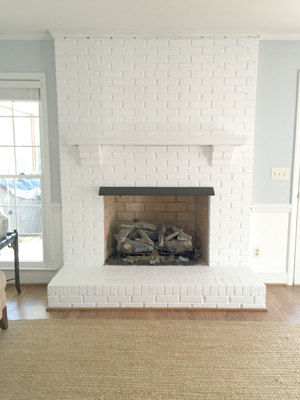 How to paint a brick fireplace to lighten a room.