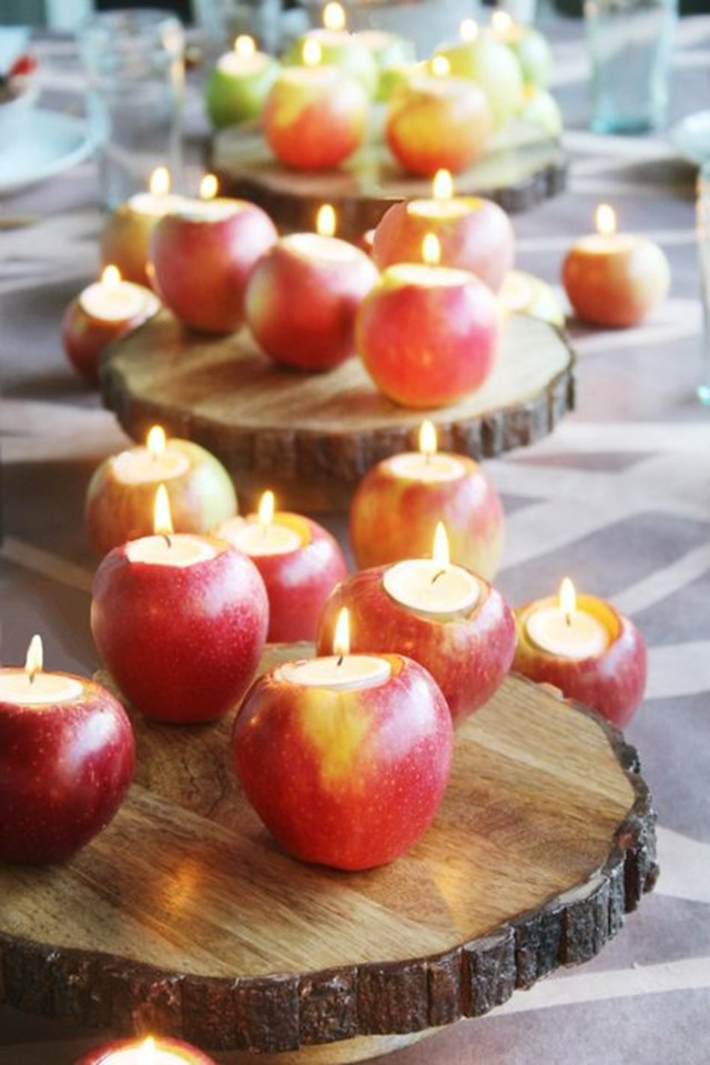 tea light candles in carved apples