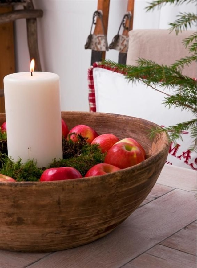 apples and candle in bowl centerpiece