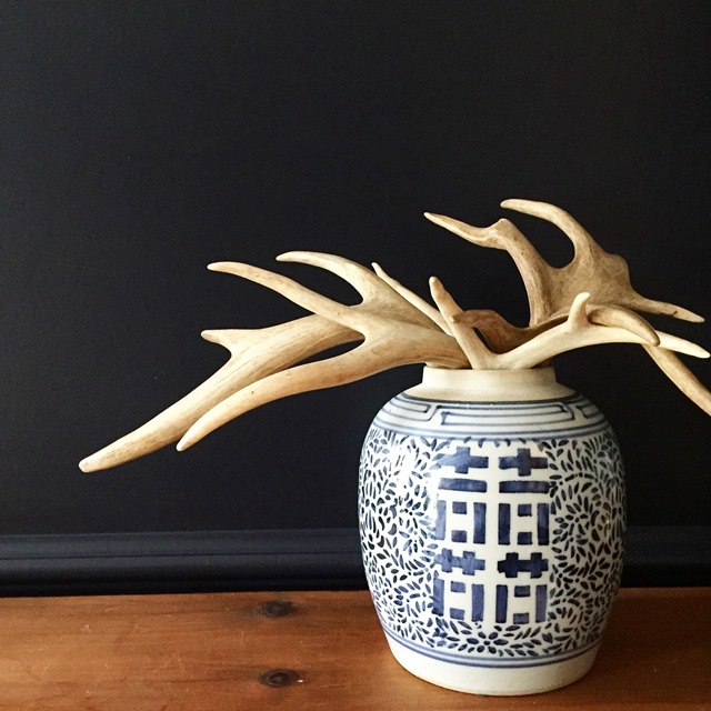 holiday decorating: antlers in a blue and white jar