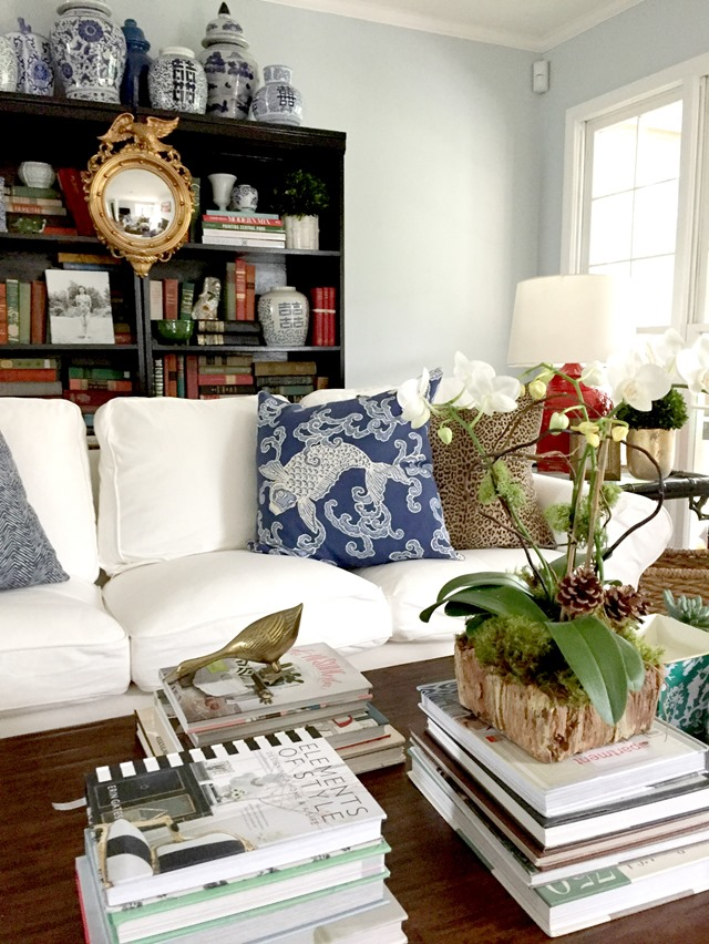 White sofa with black bookcases