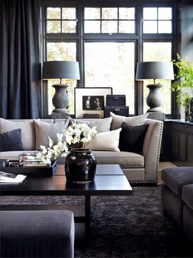black living room with painted windows