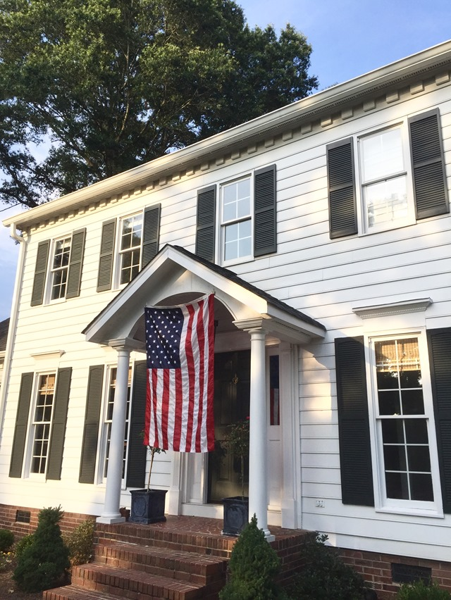 American flag on colonial house