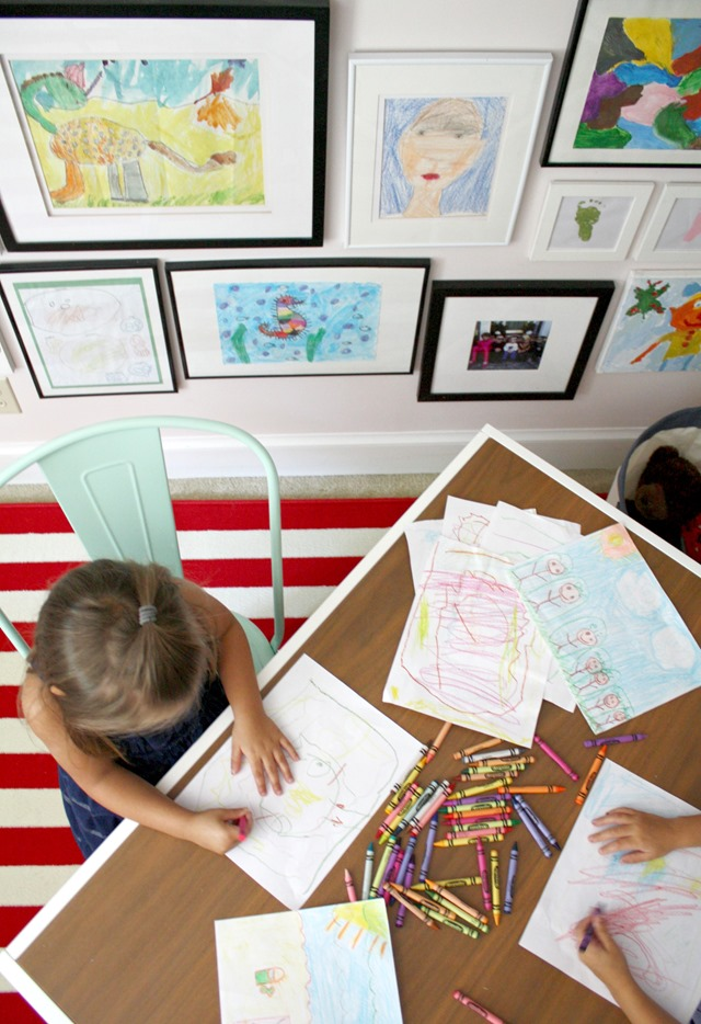 kids' artwork gallery wall