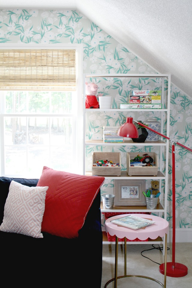 wallpaper and bookcases in playroom