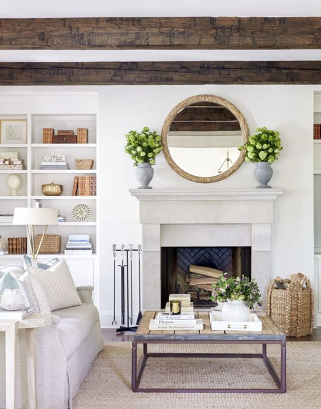 round_mirror_above_mantel