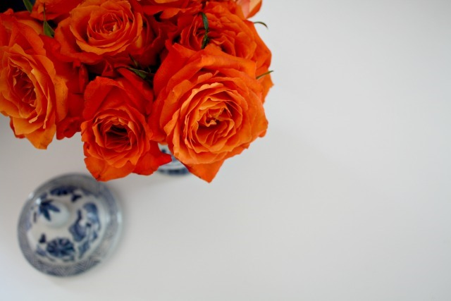 orange roses white desk