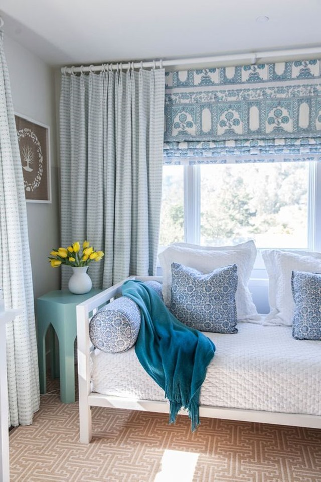 patterned roman shade layered with curtains
