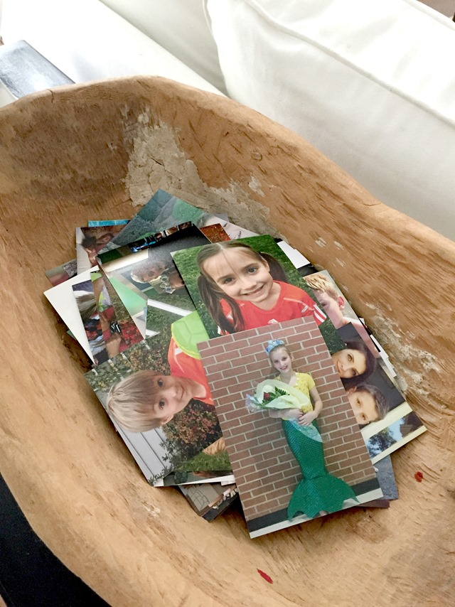 photographs in wooden bowl