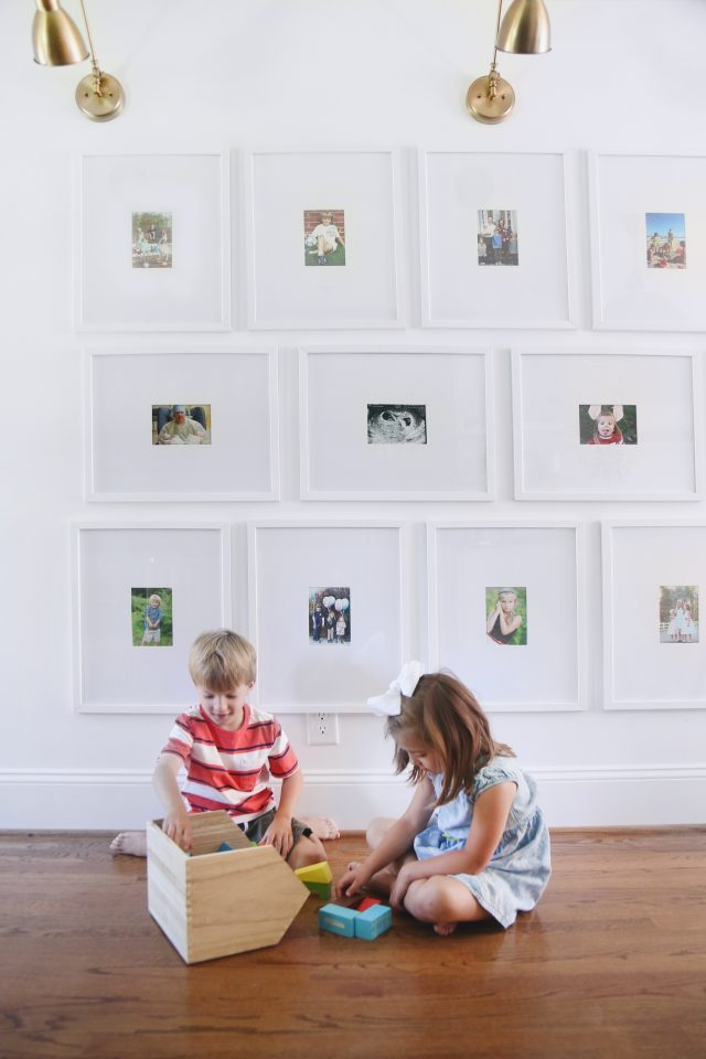 kitchen family gallery wall with sconces