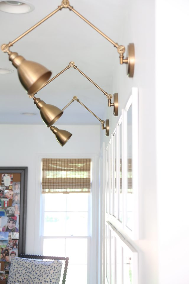 brass library sconces gallery wall