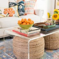 rattan ottomans under acrylic coffee table