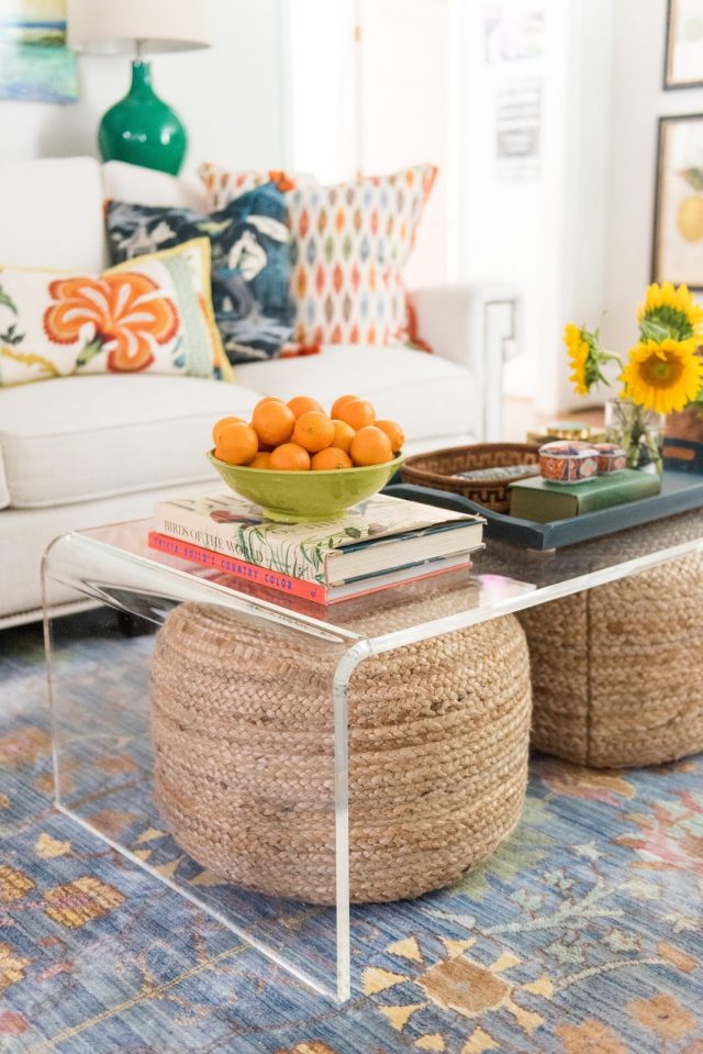 Image Amanda Louise Interiors A Of Woven Ottomans Tucked Under An Acrylic Coffee Table