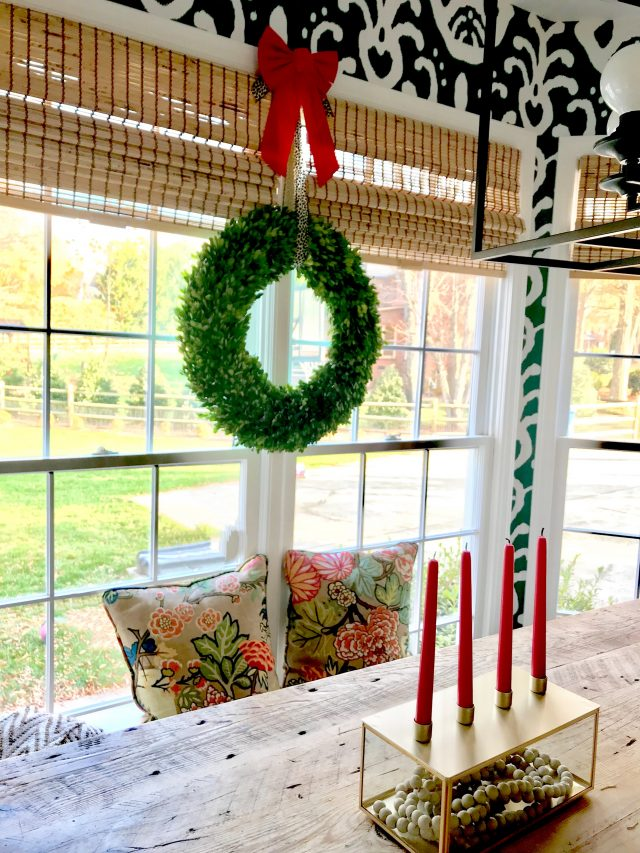 boxwood wreath and taper candles