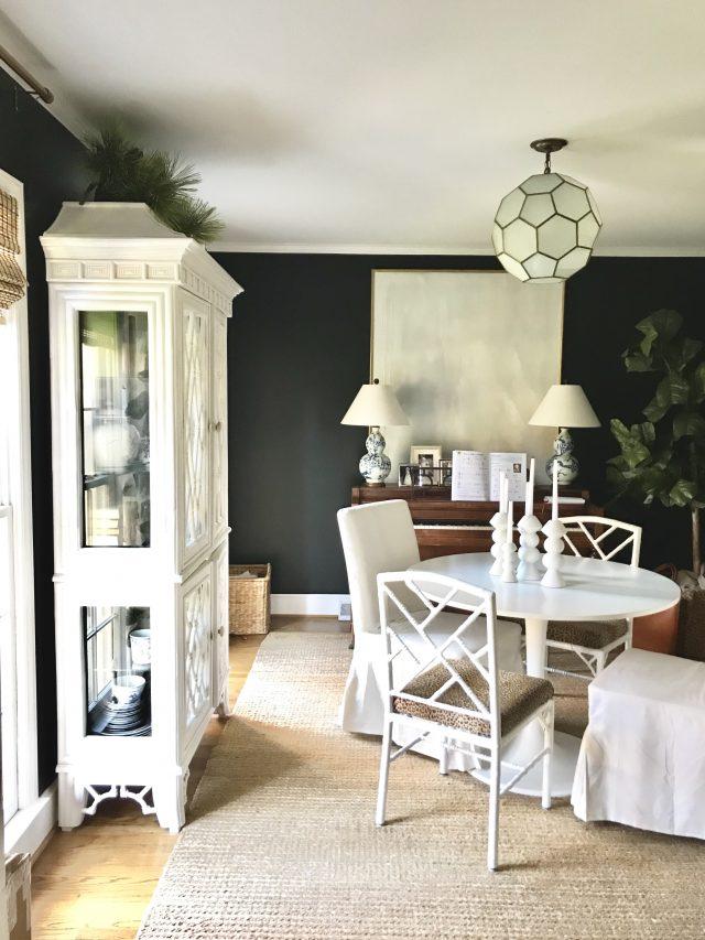 black dining room Christmas greenery