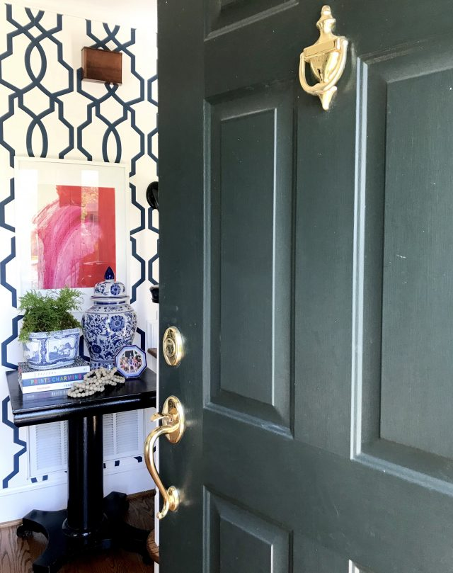 pairing art with entryway wallpaper