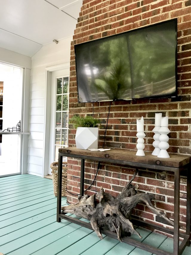 screened-porch-tv-and-painted-floor