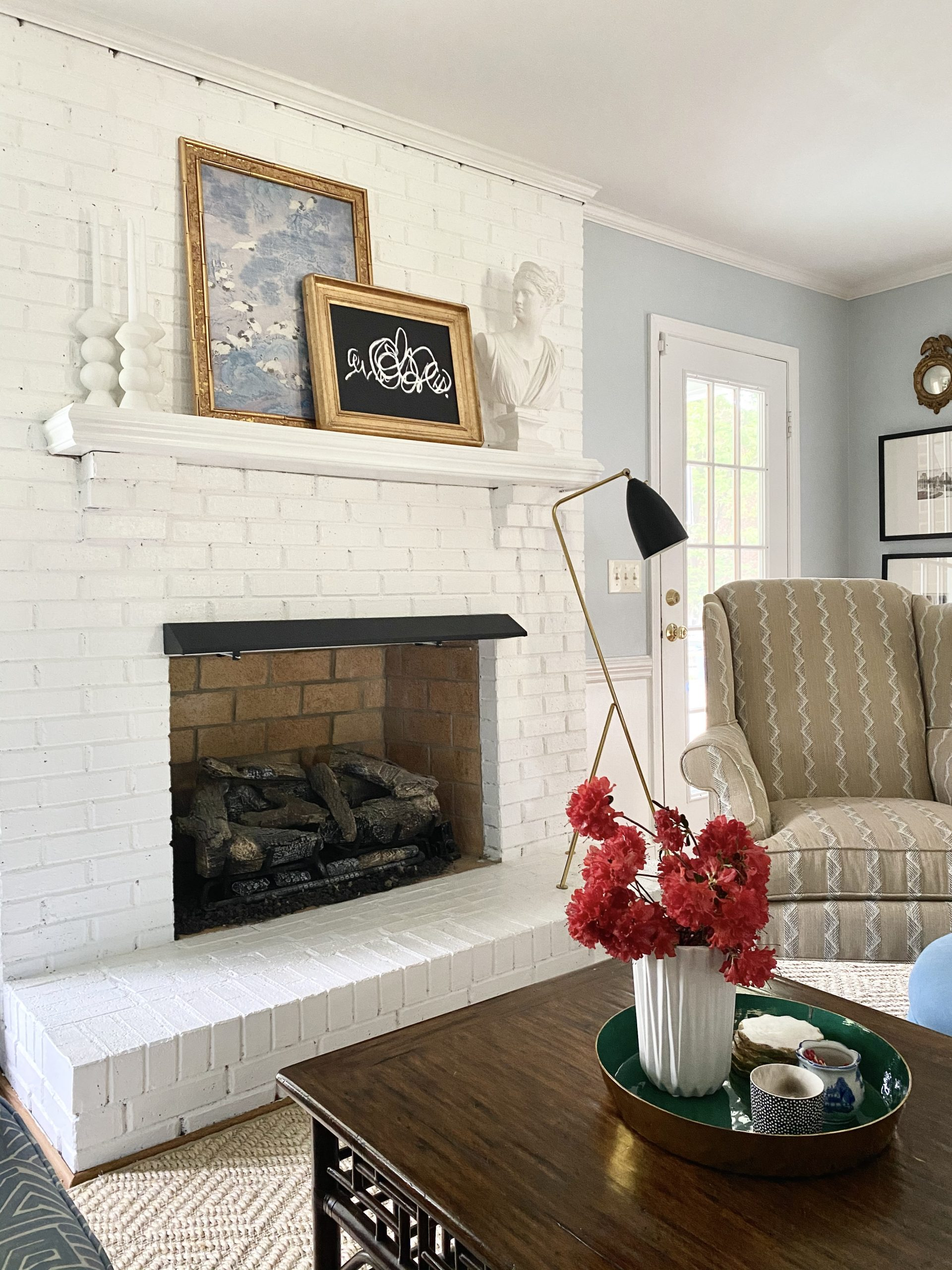 lighten-up_living_room_decor_white_brick_fireplace